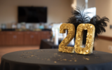 gold sequin 20 number on table with black tablecloth